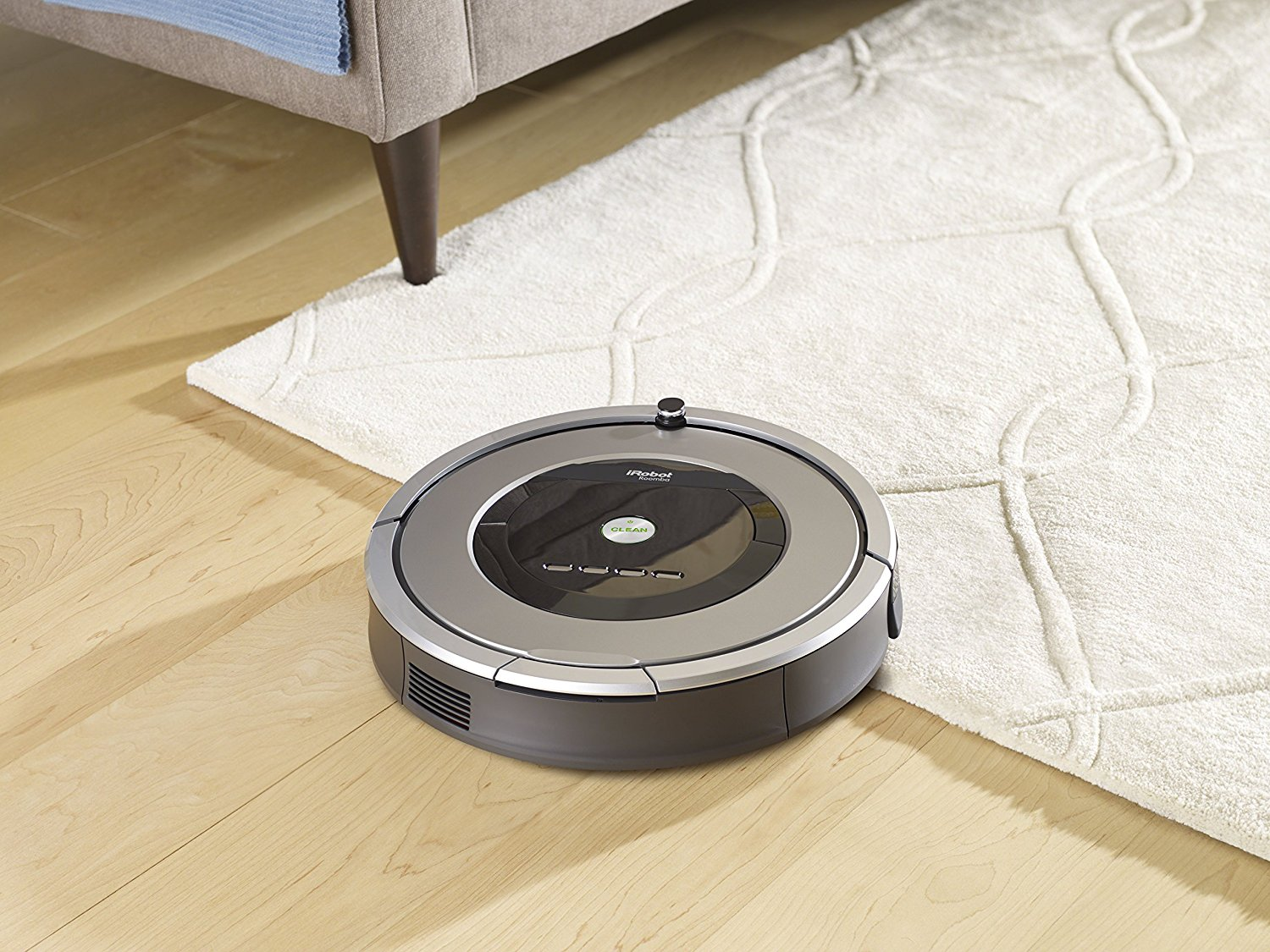 Robotic vacuum cleaner transition from floor to carpet