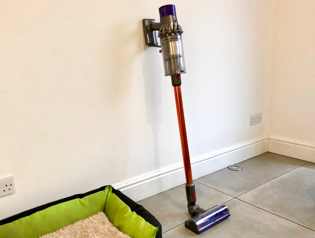 Dyson Cyclone V10 Absolute leaning on a wall